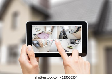 home camera cctv monitoring monitor smart house video system hand exterior closeup concept - stock image