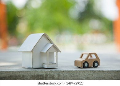 Home and car artificial on the concrete.