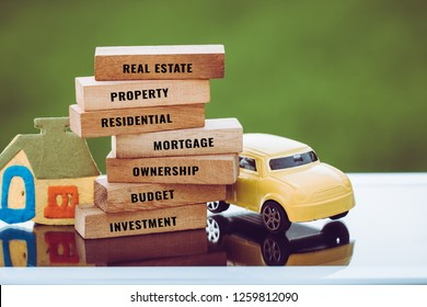 Home Car for mortgage and real estate concept: House vehicle model with wooden blocks for letter e.g investment,budget,ownership,residential,property etc. Idea show management financial for dream life