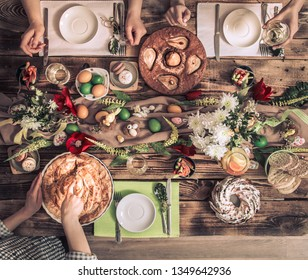 Home Celebration of friends or family at the festive Easter table with Easter cake, top view, celebration Concept