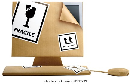 home computer wrapped up in brown paper on a white background