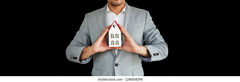 Home Concept : Real estate agent with house model at Metal. Love home. New house. Renovate. Construction Building. Housing loan. Mortgage. Financial Agent. Property Investment. House Mortgage.