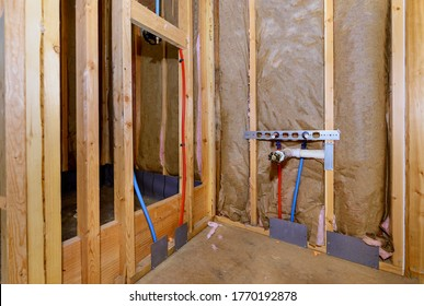 Home construction with hot red and cold blue pex pipe layout in new bathtub house PVC waste water system