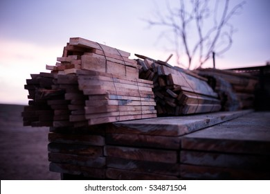 Home Construction with Wood Pile