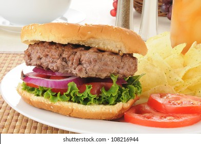 Home cooked hamburger with potato chips