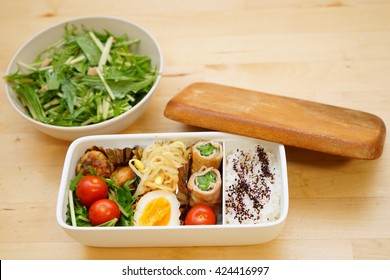 Home cooked healthy Bento lunch box with fresh vegetables and organic meals