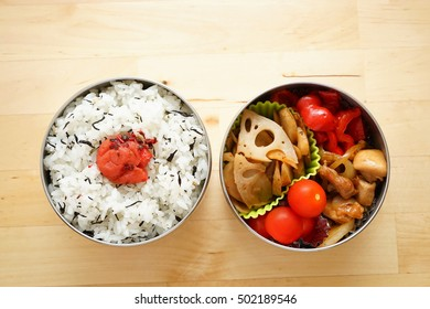 Home cooked healthy lunch box with fresh vegetables and organic meals