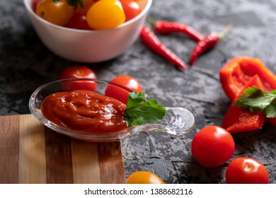 home cooked tomato sauce or ketchup in a glass cup, spicy pepper food on a table at the kitchen