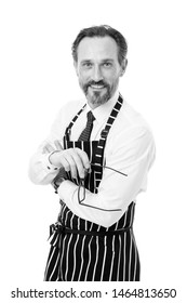 Home cooking. Household duties. Helpful husband concept. Share household responsibilities. Ready to help. Cook barber or seller wearing apron. Bearded man in apron salesman. Master of household.