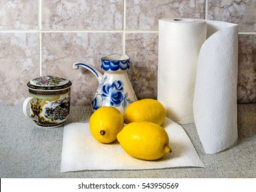 Home cooking. On the table is a paper towel roll next to the napkin are three large lemon