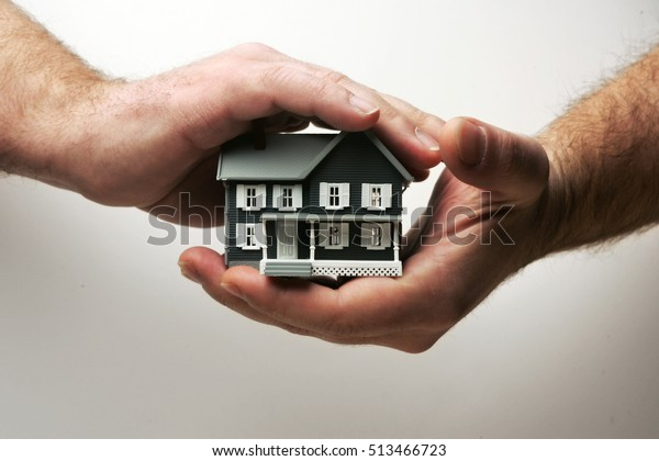 Home coverage, a house insurance concept stock image