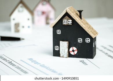 Home Decor Driftwood Ideas, Real estate property investment for signature in documents agreement contract for customer. Mortgage application form with miniature yellow wood home in resident planning