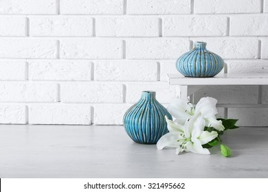 Home decor and flowers on brick wall background