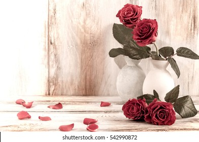 Home decor, red rose, flowers in a vase, vintage photo, retro interior with flowers.