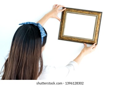 home decoration concept. put the photoframe on the wall and white background