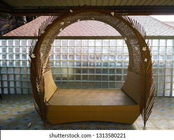 Home decoration concept. The seat is a handicraft which is woven with rattan and decorated with flowers. Which is set by the balcony. Selective focus and copy space.