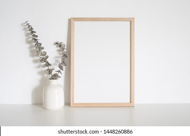 Home decoration with frame poster on table. Scandinavian style