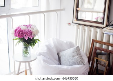 home decoration, fresh pink peonies on coffee table in white room