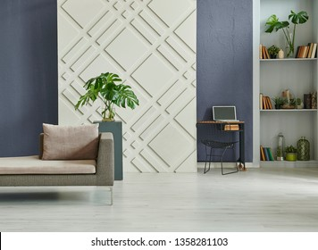 Home decoration interior room, dark blue stone wall background and decorative panel in the wall, grey bookshelf, sofa and coffee table in the room style.