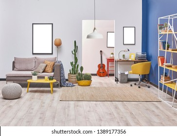 Home decoration modern living room white and blue wall frame lamp and bookshelf with working table.