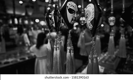 Home decoration and souvenir Chinese Sichuan Opera face changing mask. The souvenir store in Kuanzhai Xianzi valley in Chengdu. Colorful gift fron China, the lullaby of National culture.