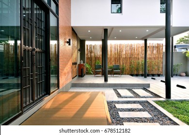 Home decoration style Loft. Decorated with iron brick doors on the back of a tree with pathways.