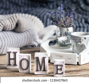 home decorations in the interior of a letter with an inscription home on a wooden background in the interior of the bedroom