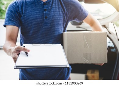 Home delivery service and working with service mind, deliveryman with boxes standing by in front of the customer house doors and holding clipboard.