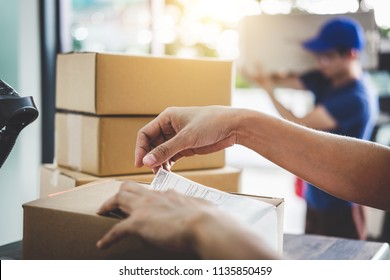 Home delivery service and working service mind, Woman working barcode scan to confirm sending customer in post office.