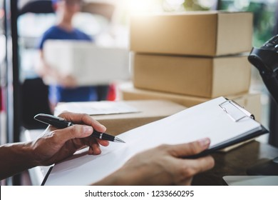 Home delivery service and working service mind, Woman working checking order to confirm before sending customer in post office.