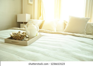 Home Design Concept. Bedroom interior design  with luxury white pillows on bed and decorative table lamp.