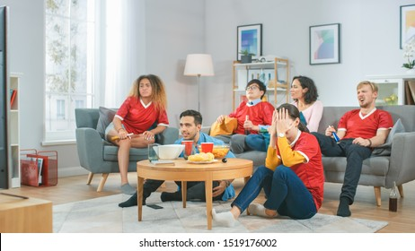 At Home Diverse Group of Sports Fans Wearing Team's Uniform Watch Sports Game Match on TV, They Cheer but the Team Loses. Cozy Room with Snacks and Drinks.