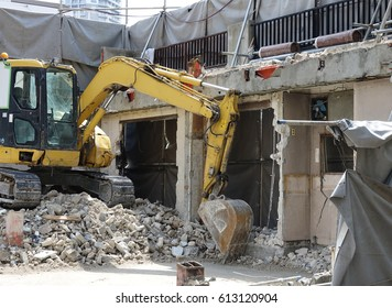 Home during demolition with shovel