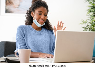 Home education. Black woman watching school lesson from home