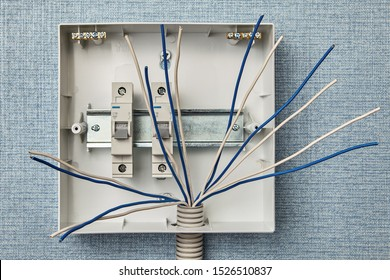 Home electrical wiring, switchboard installation. Installing a fuseboard or circuit breakers in a household electrical system. Electricity control panel of a residential building.