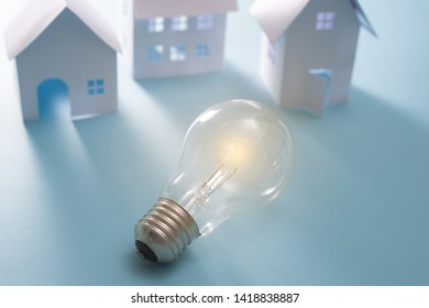 Home Energy with light bulb on the blue background