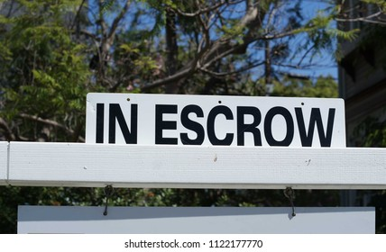 Home in Escrow Sign