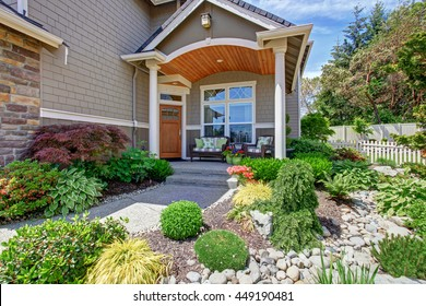 Home exterior with concrete patio area and nice landscaping desing around