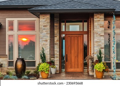 Home Exterior Detail with Reflection of Colorful Sunset