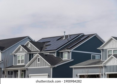 Home exterior with solar panels using sunlight as alternative electricity source