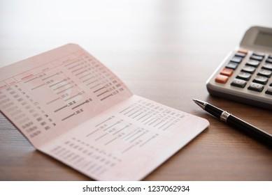 home finance concept. pen ,bank book and calculator on accountants desk.