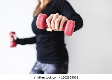 home fitness and online coaching concept, woman in sporty clothes holding dumbbell and exercising the upper body