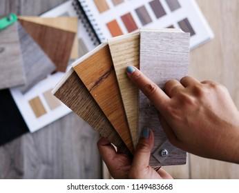 Home flooring choosing by owner for luxury vinyl wood floor tiles style