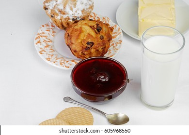 Home food & drink healthy lifestyle concept: Healthy homemade breakfast. Milk, jam bakery. Milk, biscuit, jam, cake  cookie. White linen tablecloths Light background Top view With flying fly