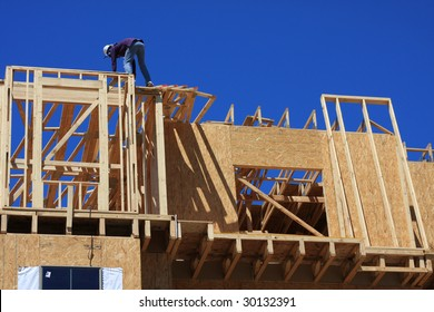 Home frame with construction worker present