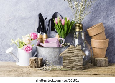 Home and garden concept of gardening tools and flowers on the old wood