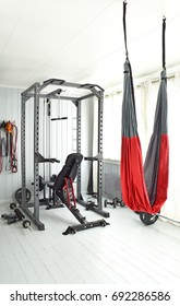 Home gym equipment . Private gym in luxury home, Empty room with fit equipment left after practice, Healthy lifestyle concept, Small gym room with exercise equipments. House interior, Arendal. Norway.