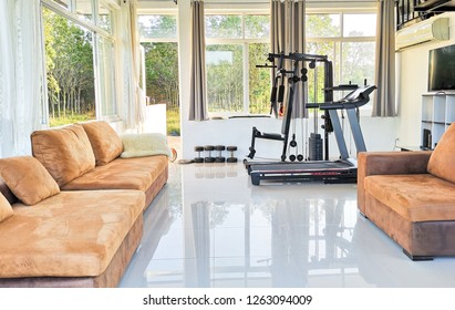 Home gym. Private gym at home, luxury, Small home gym With bench With dumbbells, Interior of New modern Equipment, apartment, different exercise Equipments