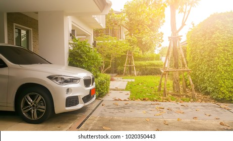 Home happy Concept . Beautiful exterior of newly built luxury home and car park at warm morning light .