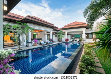 home or house building  Exterior  and interior design showing tropical pool villa with green garden, with sun bed and blue sky
